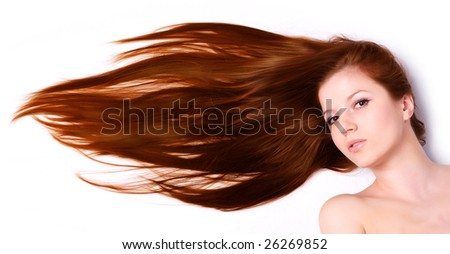 young beautiful woman with long brown hair - stock photo