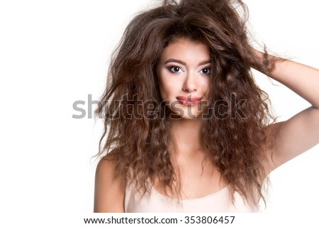Young beautiful woman with long curly hair. Woman beauty portrait. Unruly hair - stock photo