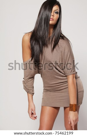 Young beautiful woman with long dark hair. - stock photo