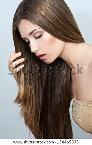 young beautiful woman with long glossy hair - stock photo