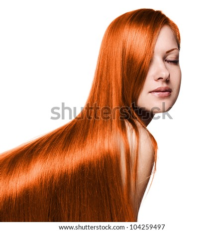 young beautiful woman with long red hair - stock photo