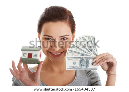 Young beautiful woman with money and house . Isolated on white.  - stock photo