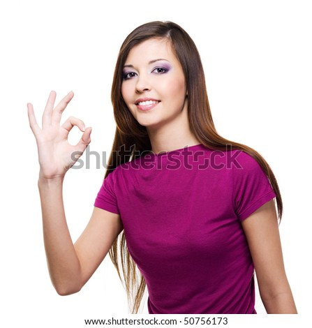 Young beautiful woman with okay gesture - isolated on white - stock photo
