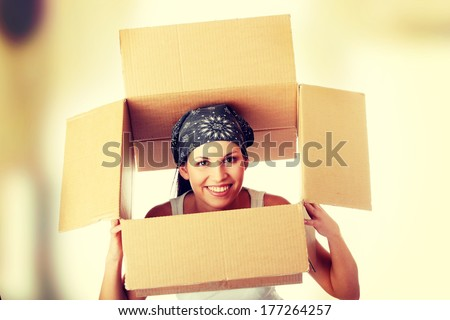 Young beautiful woman with packages for house moving   - stock photo