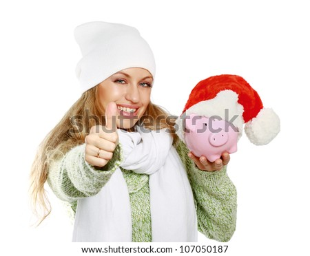 Young beautiful woman with piggy bank (money box) and showing ok, isolated on white background - stock photo
