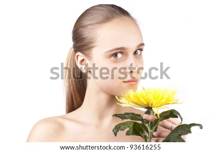 young beautiful woman with portrait of yellow flower isolated on a white background - stock photo