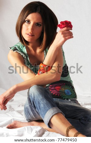 Young beautiful woman with red rose - stock photo
