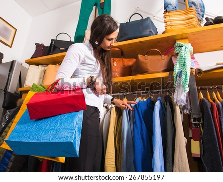 Young beautiful woman with shopping bags in the mall - stock photo