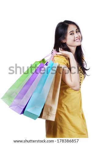 Young beautiful woman with shopping bags isolated on white background - stock photo