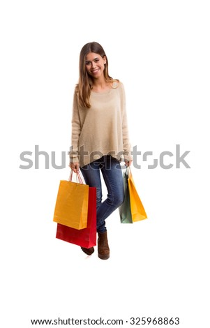 Young beautiful woman with shopping bags, isolated over copy space background - stock photo