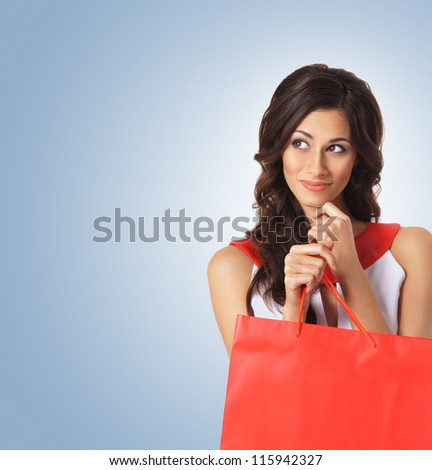 Young beautiful woman with some shopping bag - stock photo