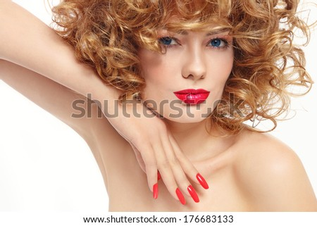 Young beautiful woman with stylish manicure and red lipstick - stock photo