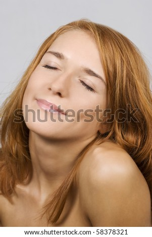 Young beautiful woman with the closed eyes - stock photo