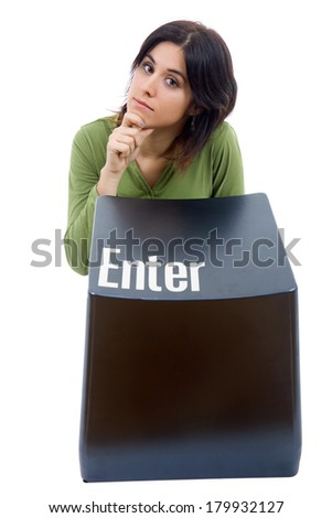 young beautiful woman with the enter key - stock photo