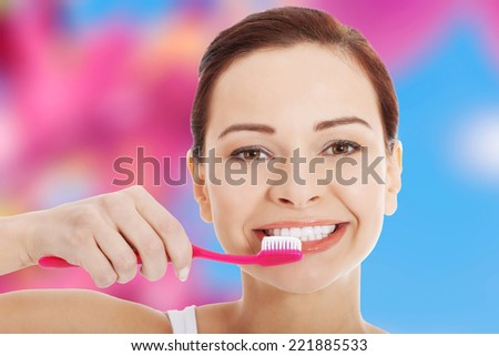 Young beautiful woman with toothbrush and paste - stock photo