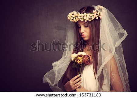 young beautiful woman with veil and wreath of flowers,  studio shot - stock photo