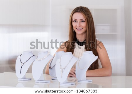 Young Beautiful Woman Working In Jewelry Shop - stock photo