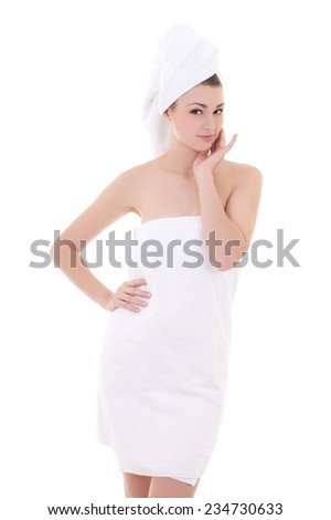 young beautiful woman wrapped in towel isolated on white background - stock photo