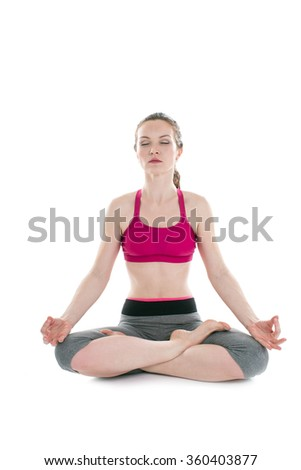 young beautiful woman yoga posing on a white  background - stock photo