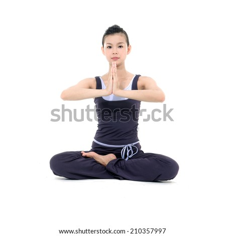 young beautiful yoga posing on a studio - stock photo