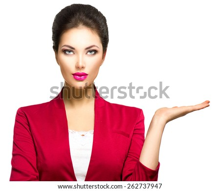 Young beauty business woman showing empty copy space on the open hand palm for text, white background. Happy girl presenting point watching on it. Proposing a product. Gestures for advertisement - stock photo