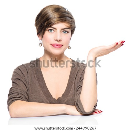 Young beauty casual woman showing empty copy space on the open hand palm on white background. Girl presenting point by raised hand for text. Gesture for selling product, advertisement. Presentation - stock photo