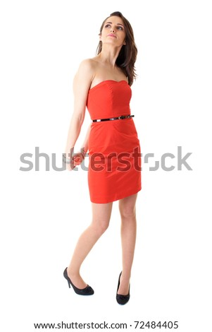 young beauty female in red strapless dress makes some funny poses, isolated on white - stock photo