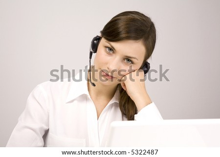 Young beauty girl with laptop. VoIP. Call center. Helpdesk. - stock photo
