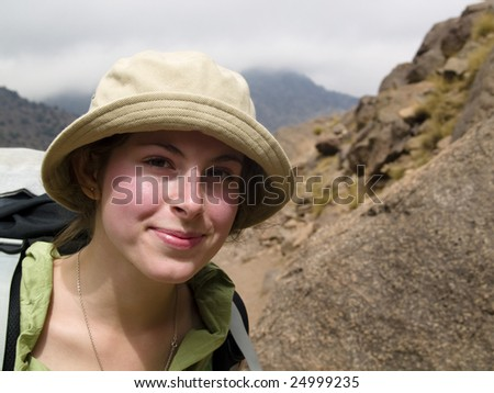 Young beauty happy face. Cloudy day in Atlas - Morocco. - stock photo