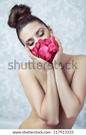 Young beauty holding roses - stock photo