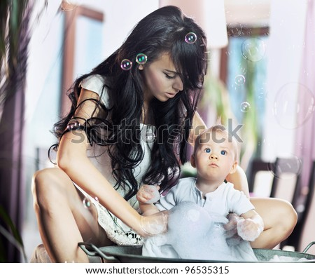 Young beauty mother and her child - stock photo