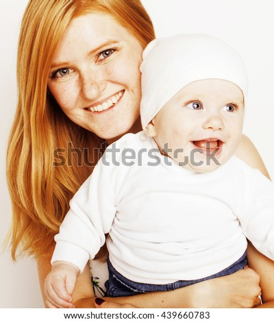 young beauty mother with baby, red head happy family isolated close up - stock photo