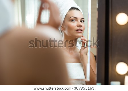 Young beauty woman caring about her skin - stock photo