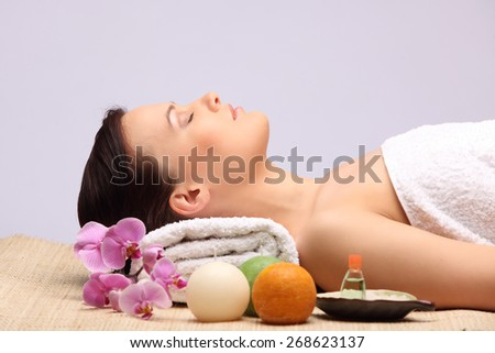 Young beauty woman in a spa with closed eyes studio - stock photo