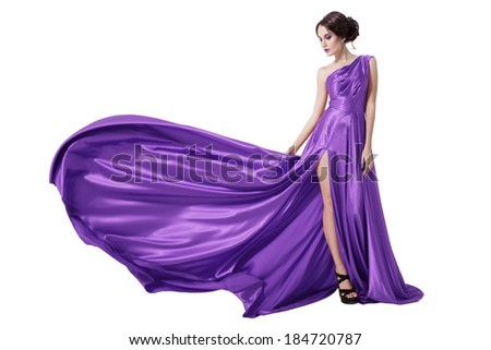 Young Beauty Woman In Fluttering Violet Dress. Isolated On White Background. - stock photo