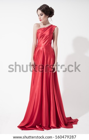 Young beauty woman in red dress. White background. - stock photo