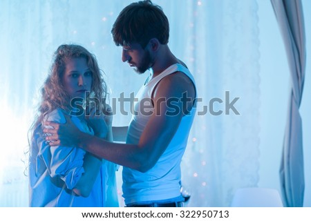 Young beauty woman splitting up with husband - stock photo
