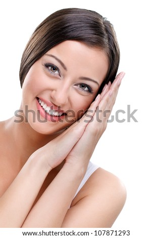 young beauty woman touching her face - stock photo