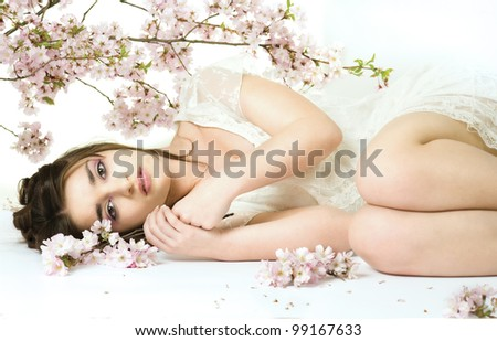 Young beauty woman with cherry blossom - stock photo