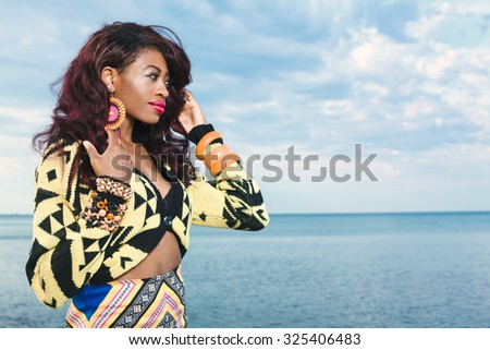 Young beuatiful African American girl relaxing at the beach. - stock photo
