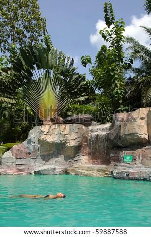 Young Bikini Woman Floating In A Pool! - stock photo