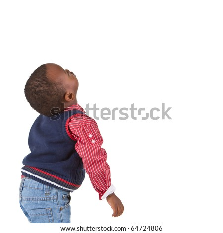 Young black baby boy looking up. Isolated over white background. - stock photo