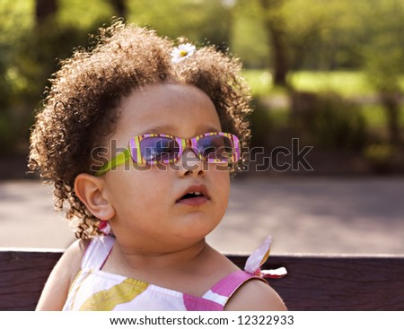 Young black baby girl with glasses - stock photo