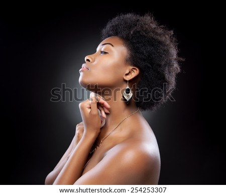 Young black beautiful woman with afro hairstyle - stock photo