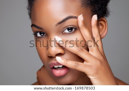 Young black beauty with perfect skin - stock photo