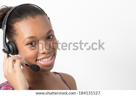 Young Black Call Centre Agent talking to a client - stock photo