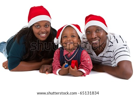 Young black family with a little boy are getting ready for christmas. Happy and cute image. - stock photo