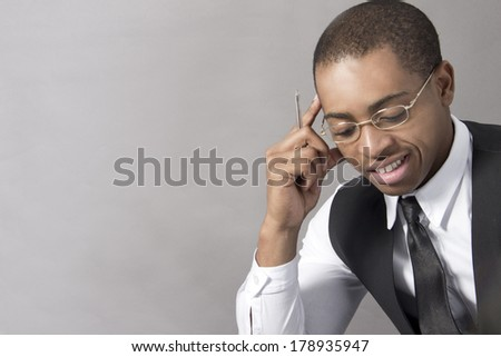 Young Black Man in the office behind his desk - stock photo