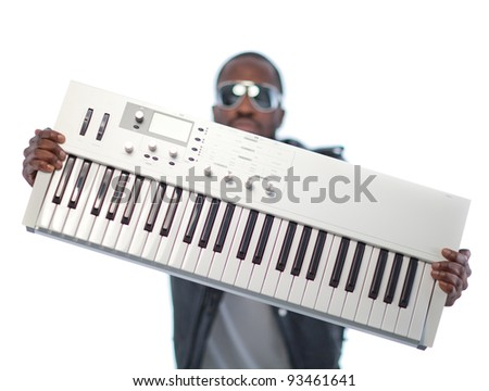 Young black man with headphones and a keyboard. Isolated over white. - stock photo