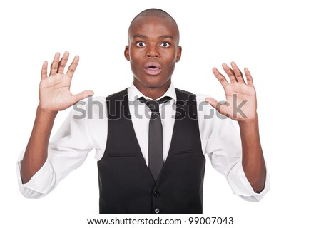 young black man with his hands up and looking scared - stock photo